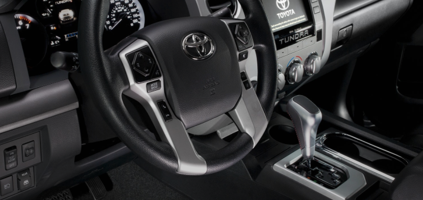 The driver's area of the cabin in a 2018 Toyota Tundra TRD Sport.