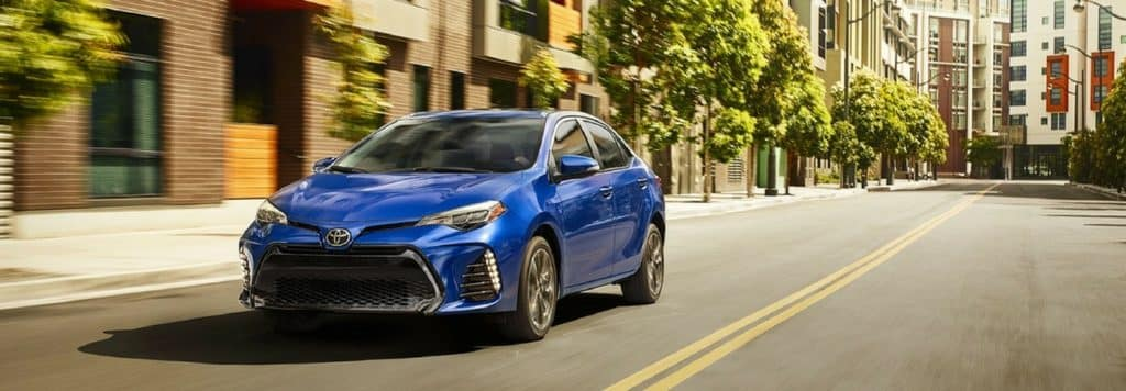 The 2018 Toyota Corolla driving down the street.