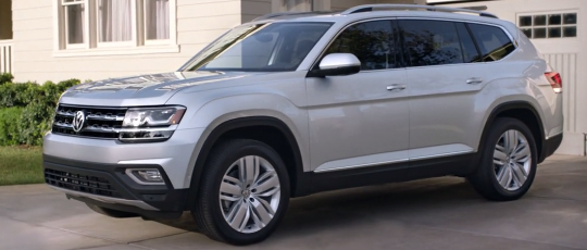 The 2018 Volkswagen Atlas parked in front of a house.