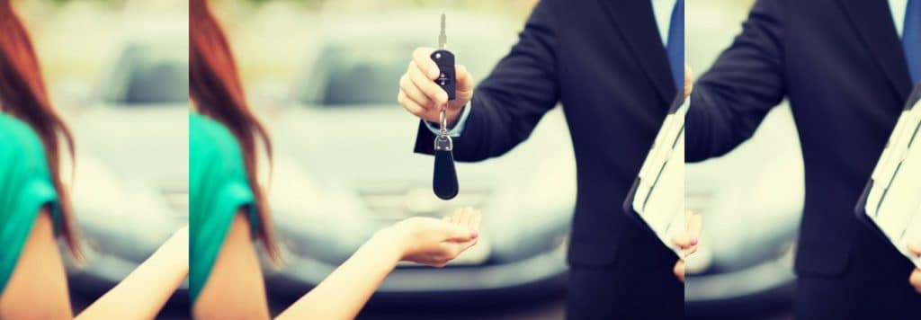 A salesman handing car keys to a woman, in a blog post about Volkswagen TDI.