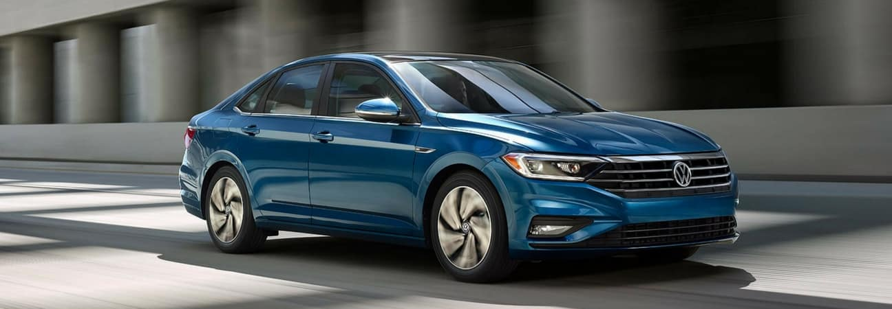 The 2019 VW Jetta driving down a road