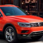 2018 Orange Volkswagen Tiguan parked curbside in the city