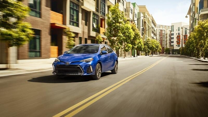 Blue 2018 Toyota Corolla on city street
