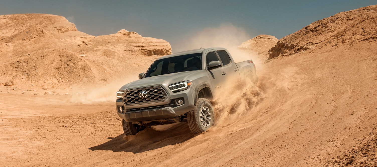 2020 Toyota Tacoma driving down sand dune. Available now at Toyota of Newnan