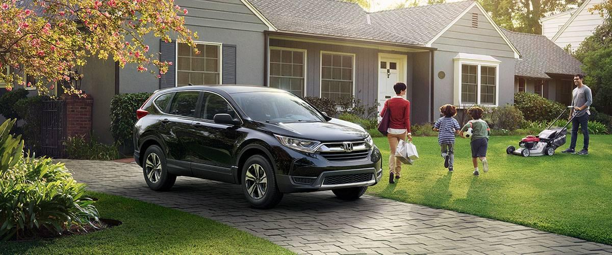 2017 Honda CR-V LX in front of house with family
