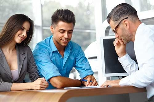 Couple looking at options for buying a car