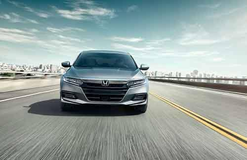 2018 Honda Accord Sedan driving down a highway