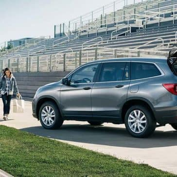 2019 Honda Pilot parked on sidelines of a football field