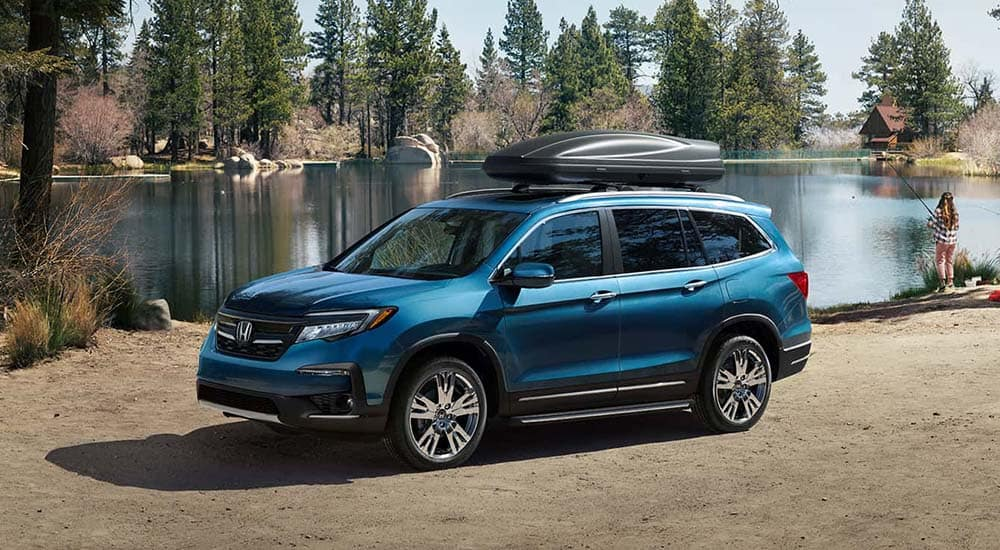 2019 Honda Pilot parked at camping site on lakefront