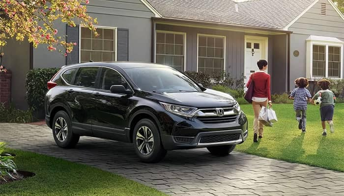 2019 Honda CR-V Parked in Front of House with family