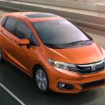 Orange Honda Fit Driving